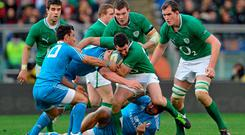 Rob Kearney, supported by Peter O'Mahony, Conor Murray and Devin Toner attempts to break through the Italian defence in 2013