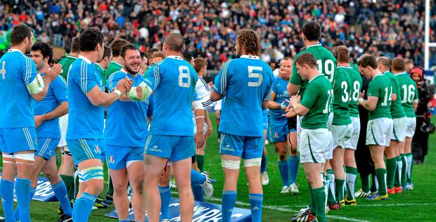 The Italian players celebrate their victory as Brian O'Briscoll and his Ireland team-mates applaud the Italian's from the pitch after the game in 2013