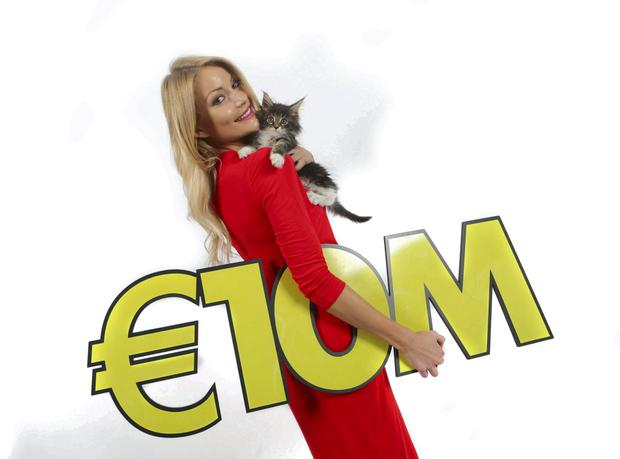 Model Kerri-Nicole Blanc and her litter of 10 lucky kittens celebrate Wednesday's big Lotto jackpot which is an estimated €10 million