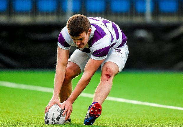 Colm Mulcahy, Clongowes Wood College, touches down for a try v Castleknock
