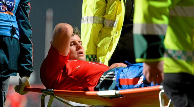 Dave O'Callaghan, Munster, is stretchered off after picking up an injury