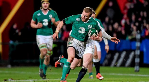Keith Earls, Ireland Wolfhounds, breaks through the tackle of Elliot Daly, England Saxons