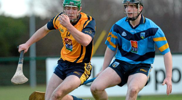 DCU's Cathal Curran in action against Sean Murphy of UCD