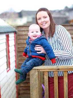 Emma Leahy with baby AJ playing on the back garden Photo: Ronan Lang/Feature File
