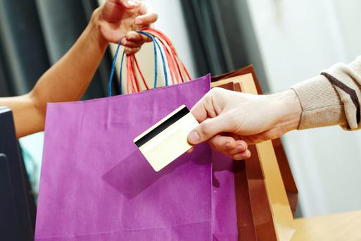 Close-up of mans hand passing over credit card to shop assistant after shopping