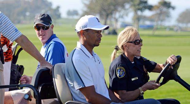 Tiger Woods withdraws from the Farmers Insurance Open golf tournament at Torrey Pines Municipal Golf Course after his 12th hole