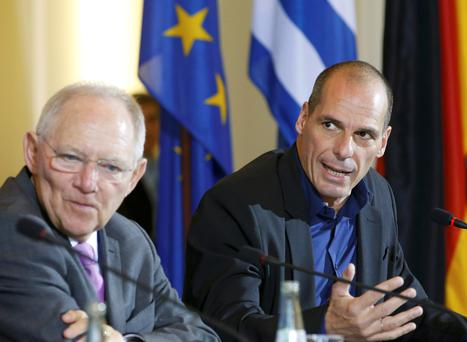 Greek Finance Minister Yanis Varoufakis and German Finance Minister Wolfgang Schaeuble (L) look discontent as they address a news conference following talks at the finance ministry in Berlin. Photo: Reuters