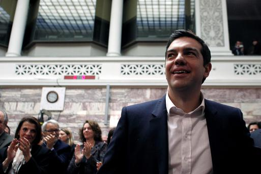 Greek Prime Minister Alexis Tsipras looks on as his colleagues applaud during a parliament session of Syriza party lawmakers at the Greek Parliament in Athens yesterday (REUTERS/Kostas Tsironis)