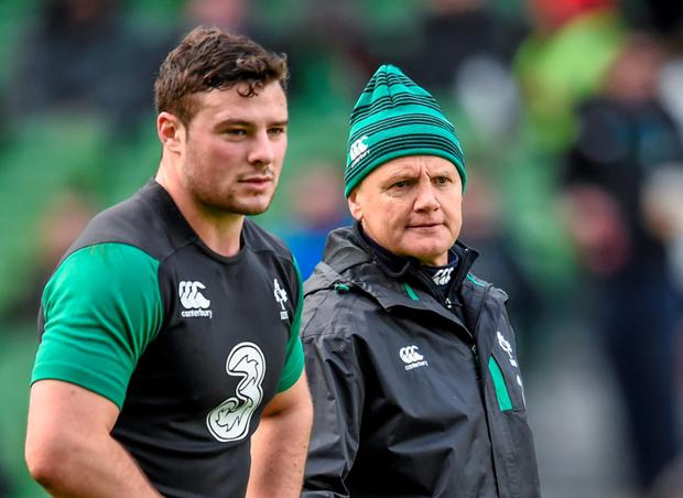 Ireland head coach Joe Schmidt and Robbie Henshaw, left, during squad training