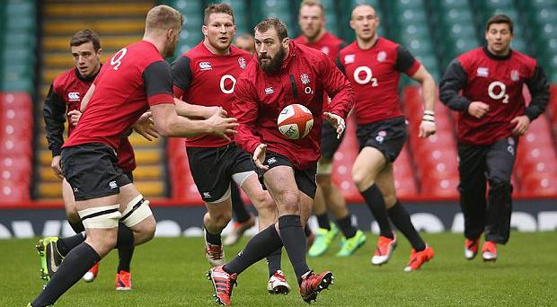 Sleight of hand: Joe Marler offloads to George Kruis during England training