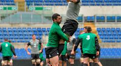 Rob Kearney lifts Paul O'Connell as the Ireland players go through their paces in the Stadio Olimpico during yesterday's Captain's run