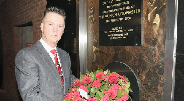 Manchester United boss Louis Van Gaal lays a wreath at the Munich Air Disaster Memorial to remember the 21 people killed on February 6, 1958. Photo: John Peters/Man Utd via Getty Images