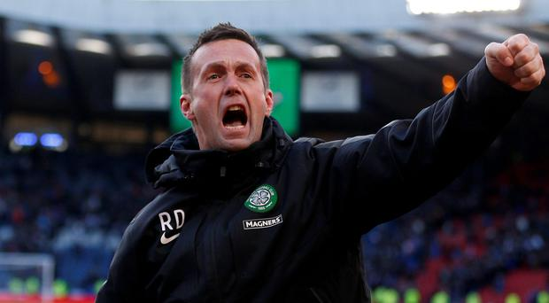 Celtic manager Ronny Deila is delighted that none of his top players, such as defender Virgil van Dijk, have been poached. Photo: REUTERS/Russell Cheyne