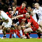 Jonathan Joseph scores England's opening try at the Millennium stadium last night