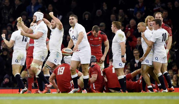 England celebrate defeating Wales at the final whistle in their Six Nations Rugby Union match at the Millennium stadium