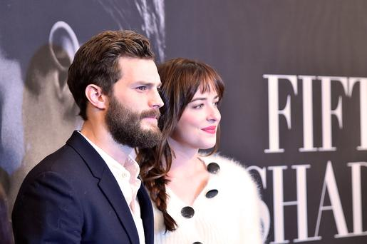 Actors Jamie Dornan (L) and Dakota Johnson attend the