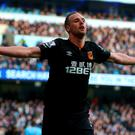 David Meyler of Hull City celebrates scoring the first goal during the Barclays Premier League match between Manchester City and Hull City at the Etihad Stadium