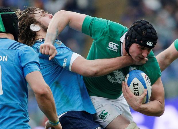 Ireland's Sean O'Brien (R) is tackled by Italy's George Biagi during their Six Nations Rugby Union match at the Olympic stadium in Rome, February 7, 2014. REUTERS/Max Rossi (ITALY - Tags: SPORT RUGBY)
