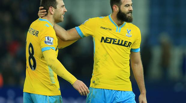 Crystal Palace's Joe Ledley celebrates with james McArthur following the Barclays Premier League match at the King Power Stadium