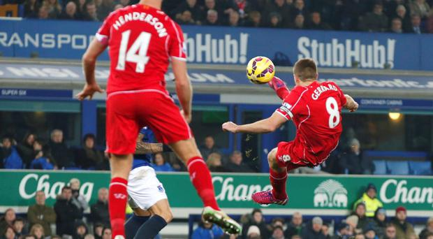 Steven Gerrard of Liverpool has a shot at the Everton goal during their English Premier League soccer match at Goodison Park