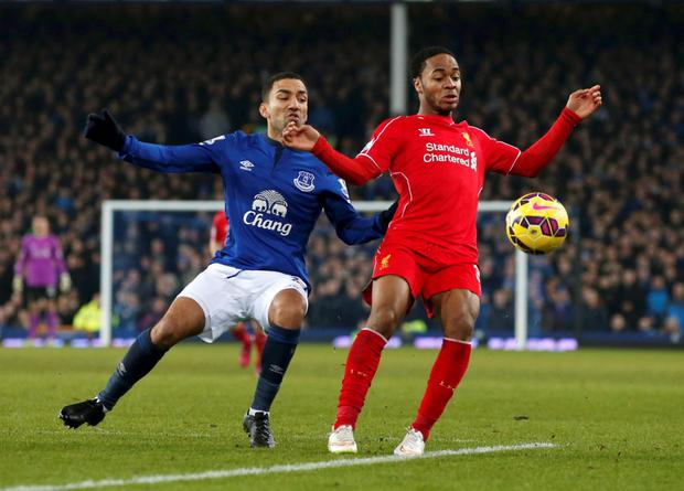 Aaron Lennon (R) of Everton challenges Raheem Sterling of Liverpool during their English Premier League soccer match at Goodison Park