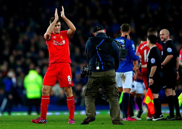 Steven Gerrard of Liverpool applauds the fans after the Barclays Premier League match between Everton and Liverpool at Goodison Park on February 7, 2015