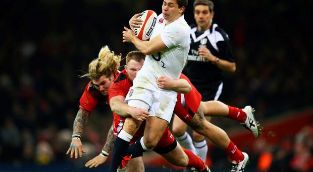 Ben Youngs of England breaks past Samson Lee and Richard Hibbard of Wales