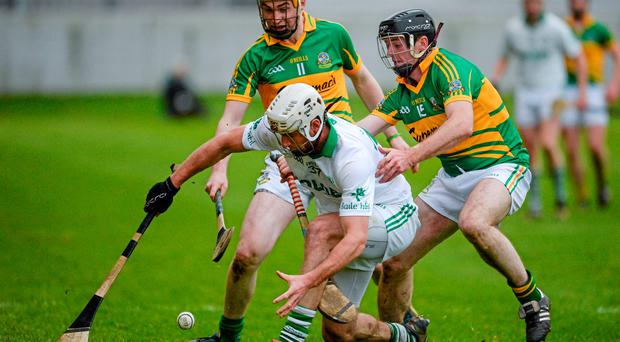 Michael Fennelly, Ballyhale Shamrocks, in action against Albert Mullins, left, and Gerard Quinn, Gort