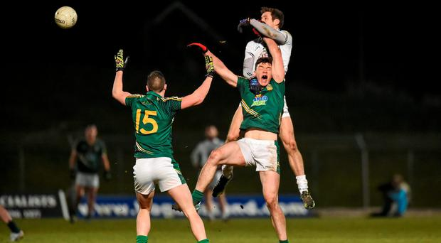 Gary White, Kildare, in action against Harry Rooney, Meath