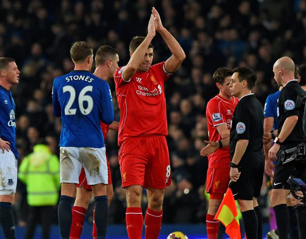 Liverpool's Steven Gerrard applauds the supporters after his final Merseyside derby