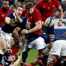 Scotland's Greig Laidlaw passes the ball