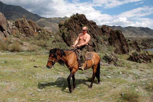 Bucolic bliss: A top-secret Pentagon report concluded that Russian President Vladimir Putin has Asperger's syndrome. The 2008 study was only based on videos of him. Photo: Reuters