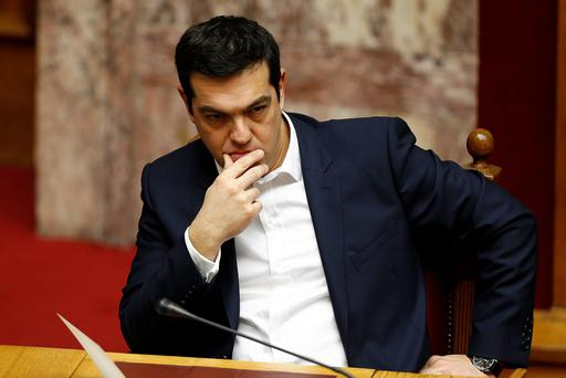 Greek Prime minister Alexis Tsipras is pictures, as Greece moves closer to the financial abyss as citizens stop paying their taxes, hopeful they will be let off by the new Left-wing government (REUTERS/Yannis Behrakis)