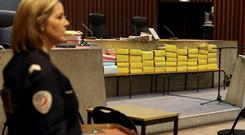 A policewoman stands guard in the courtroom before the start of a trial in the so-called Carlton Affair, in Lille, where 14 people including former IMF head Dominique Strauss-Kahn stand accused of sex offences including the alleged procuring of prostitutes (REUTERS/Pascal Rossignol)
