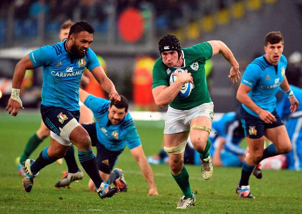 Ireland's Tommy O'Donnell (C) runs to score during the Six Nations match between Italy and Ireland at the Olympic Stadium in Rome. Photo: Getty Images