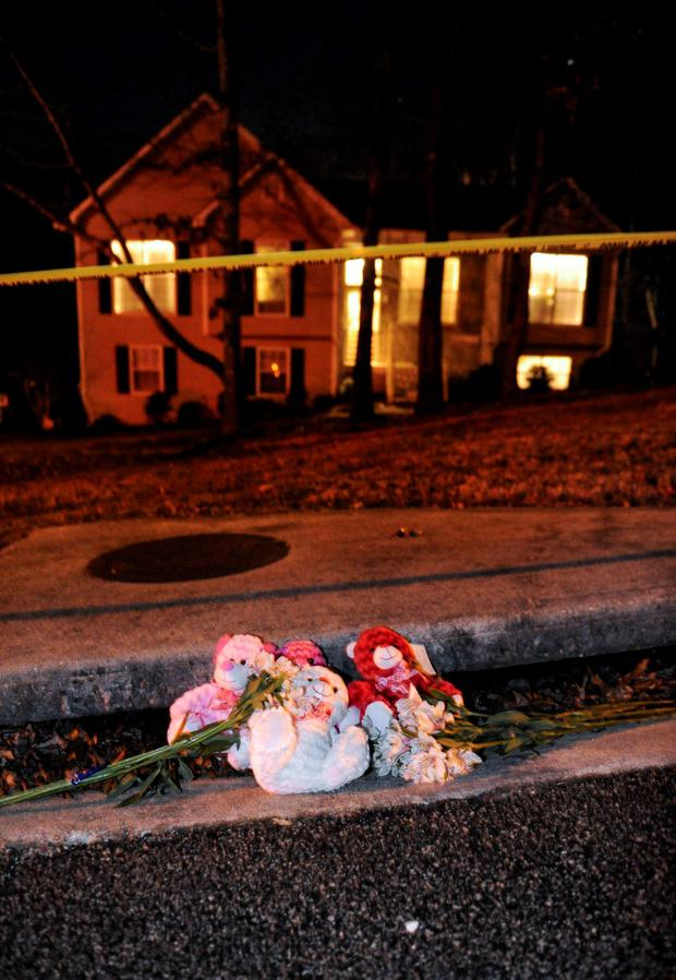 A makeshift memorial is shown outside a home in a suburban neighborhood in Douglasville, Georgia, February 7, 2015. REUTERS/John Amis