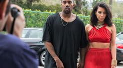 TV personality Kim Kardashian and recording artist Kanye West arrive at the Roc Nation Pre-GRAMMY Brunch