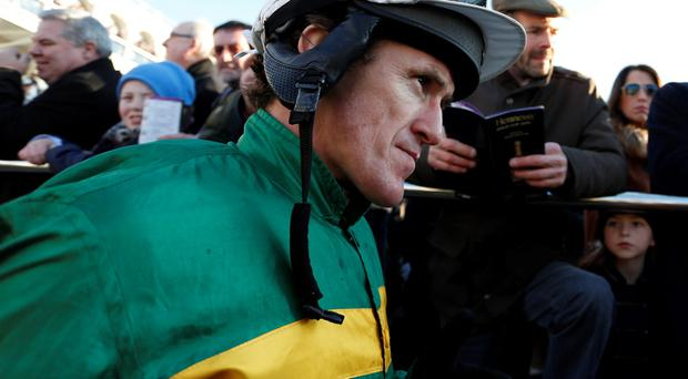 Tony McCoy makes his way into the parade ring to ride Carlingford Lough in The Hennessey Gold Cup at Leopardstown racecourse on February 08, 2015 in Dublin, Ireland. (Photo by Alan Crowhurst/Getty Images)
