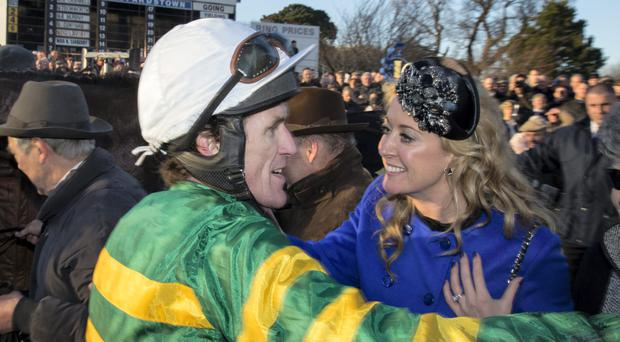 Tony McCoy celebrates with his wife Chanelle after he who his first victory with Carlingford Lough in the Hennessy Gold Cup just a day after he announced his impending retirement in a thrilling race for the Leopardstown showpiece. Picture by Fergal Phillips.