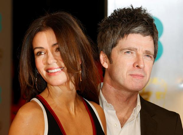 Musician Noel Gallagher and his wife Sara MacDonald arrives at the British Academy of Film and Arts (BAFTA) awards ceremony at the Royal Opera House in London February 8, 2015. REUTERS/Suzanne Plunkett