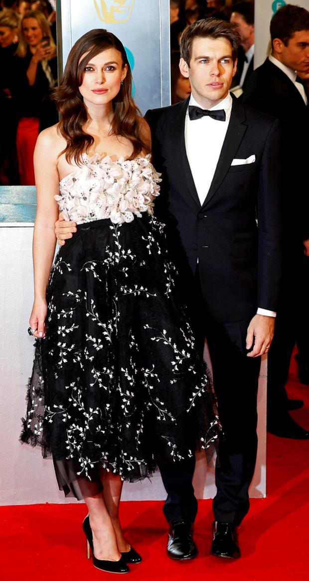 Actress Keira Knightley and her husband musician James Righton arrives at the British Academy of Film and Arts (BAFTA) awards ceremony at the Royal Opera House in London February 8, 2015. REUTERS/Suzanne Plunkett