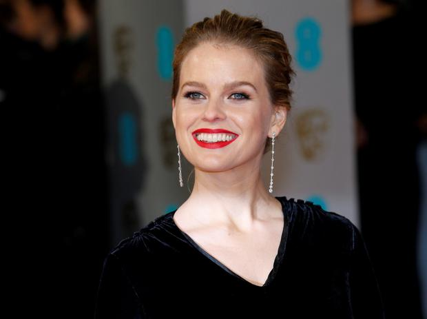 Actress Alice Eve arrives at the British Academy of Film and Arts (BAFTA) awards ceremony at the Royal Opera House in London February 8, 2015. REUTERS/Suzanne Plunkett