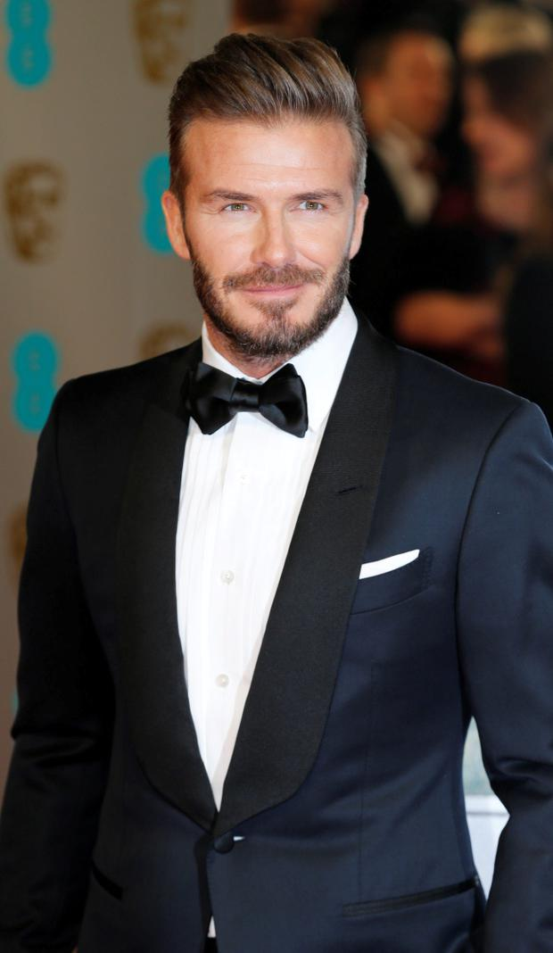 David Beckham arrives at the British Academy of Film and Arts (BAFTA) awards ceremony at the Royal Opera House in London February 8, 2015. REUTERS/Suzanne Plunkett