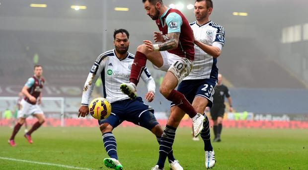Burnley striker Danny Ings controls the ball under pressure from West Bromwich Albion defenders Joleon Lescott and Gareth McAuley during their Premier League clash at Turf Moor. Photo: Michael Regan/Getty Images