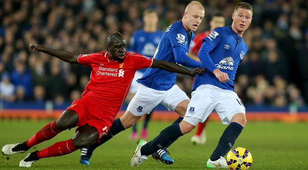 Everton midfielder James McCarthy gets his pass away despite the attentions of Liverpool's Mamadou Sakho during their Premier League clash at Goodison Park. Photo: Peter Byrne/PA Wire