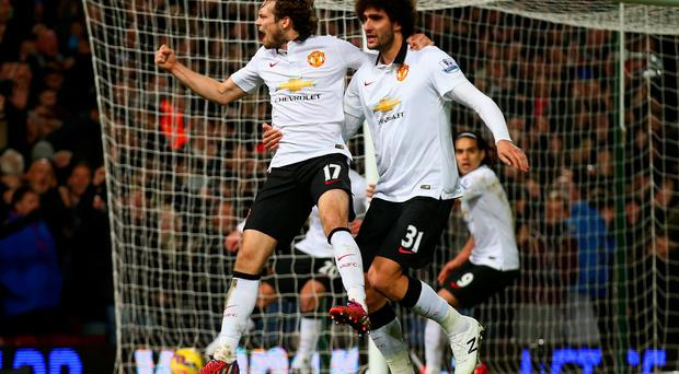 Daley Blind celebrates with Marouane Fellaini after scoring a late equaliser for Manchester United in their Premier League clash with West Ham United at Upton Park. Photo: Clive Rose/Getty Images