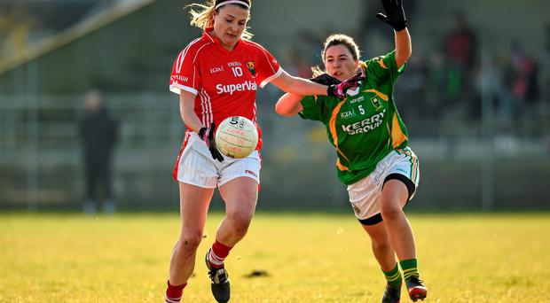 Cork's Annie Walsh holds off a challenge from Kate O'Sullivan of Kerry during their Ladies National Football League clash at Cloughduv. Photo: Paul Mohan / SPORTSFILE