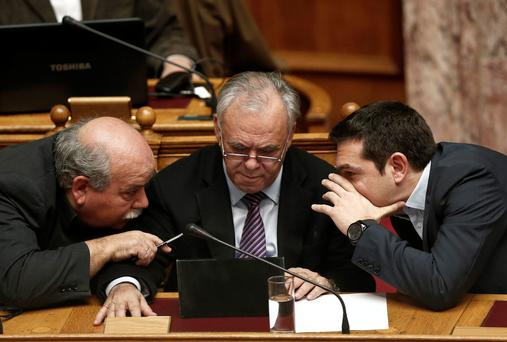 Greek Prime Minister Alexis Tsipras, right, speaks with Deputy Prime Minister Giannis Dragasakis, centre, and Interior and Administrative Reconstruction Minister Nikos Voutsis before Tsipras' first major speech in parliament in Athens (REUTERS/ Alkis Konstantinidis)