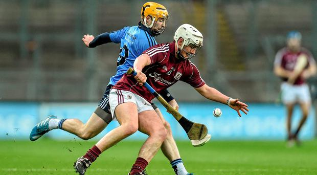 Galway's Eanna Burke battles for possession with Ben Quinn of Dublin during the Walsh Cup final at Croke Park. Photo: Ramsey Cardy / SPORTSFILE