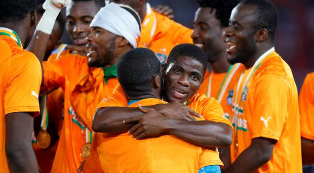Ivory Coast's players celebrate their victory over Ghana after the final of the 2015 African Cup of Nations soccer tournament in Bata February 8, 2015. REUTERS/Mike Hutchings